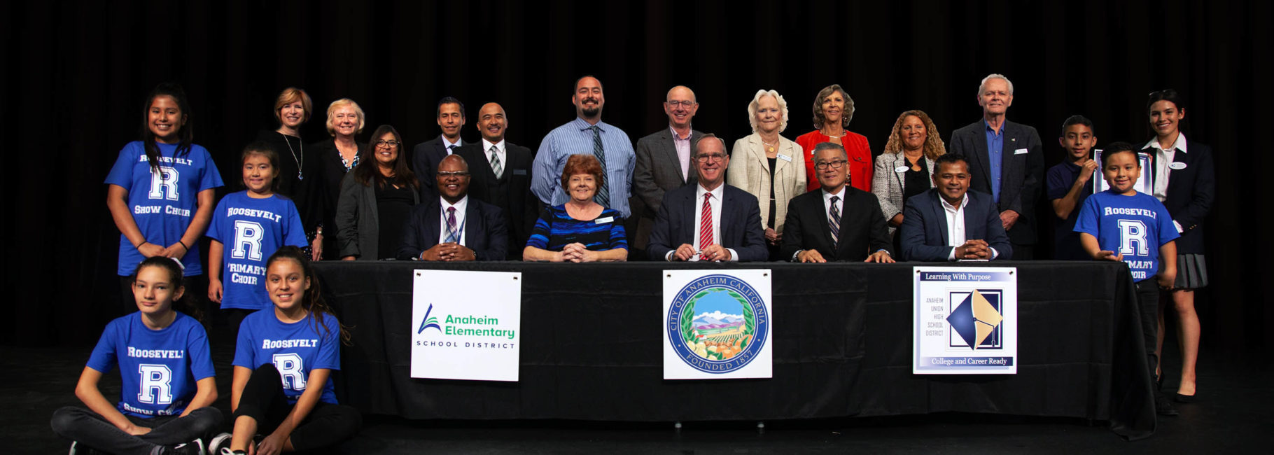 Anaheim stakeholders sign the Anaheim Pledge.
